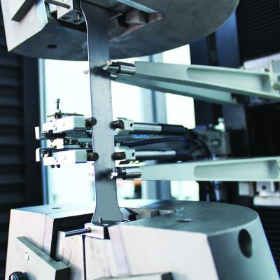 Quasar 250 for tensile test of hot rolled steel with Micron motor extensometer